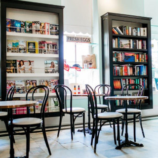 tommys folly cafe seating area tables and chairs magazine racks