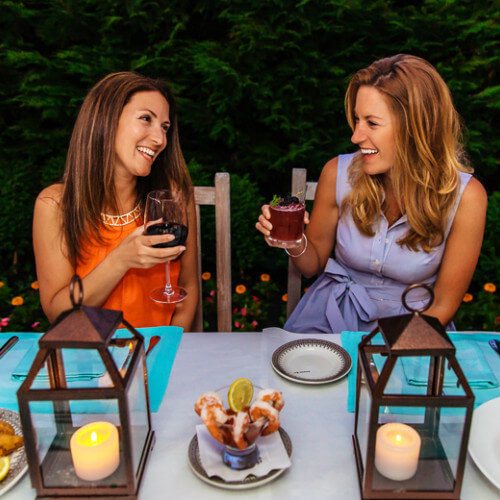 blue pig tavern patio garden women laughing holding wine