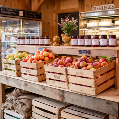 beach plum farm market wooden crates filled with fresh peaches and apples