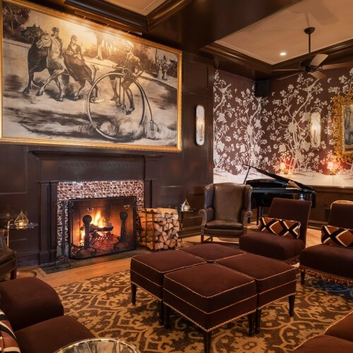 the brown room fireplace next to leather chair