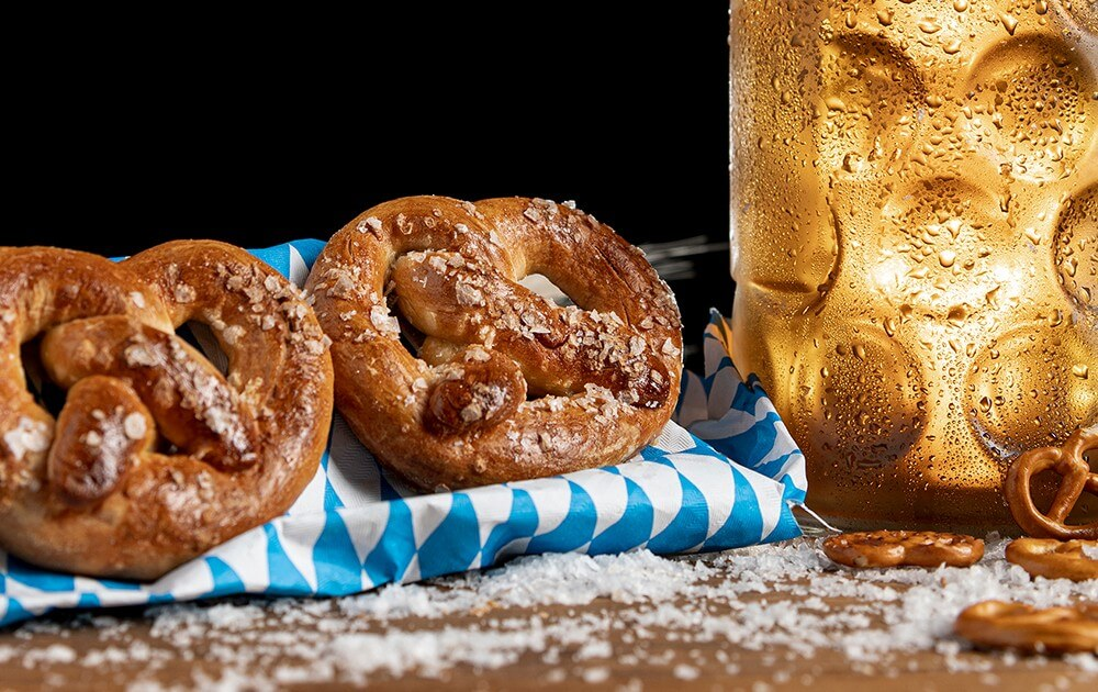 beer and soft pretzels on table