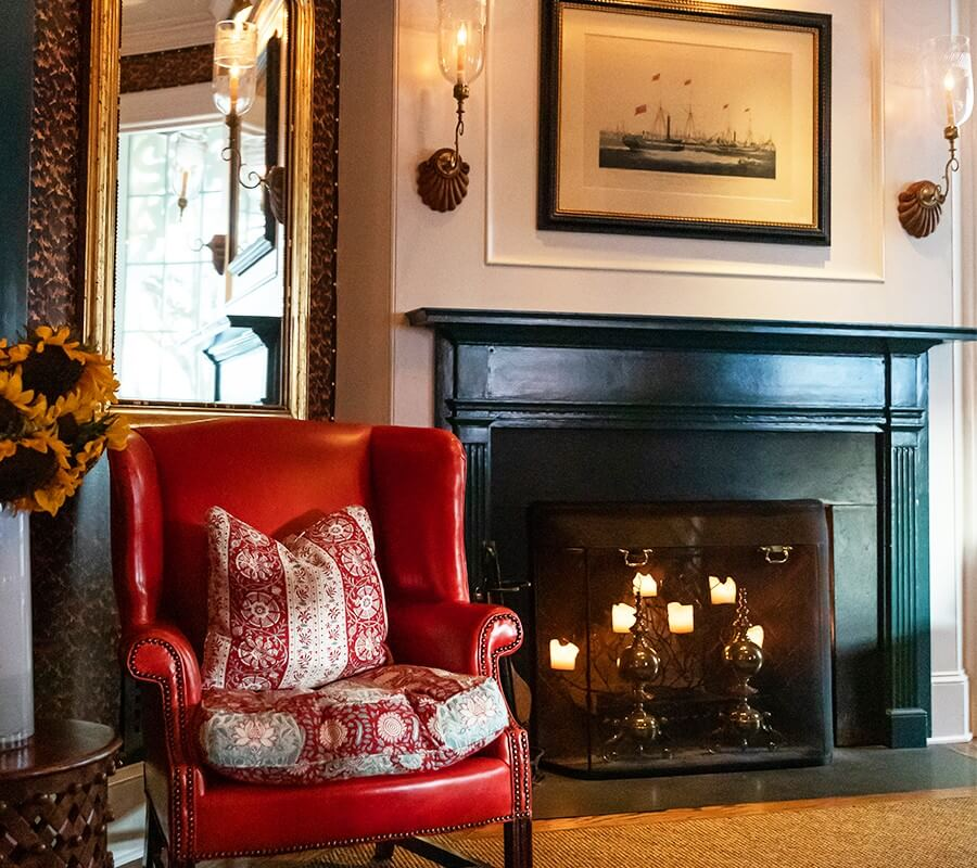 fireplace and red leather chair at the virginia hotel lobby