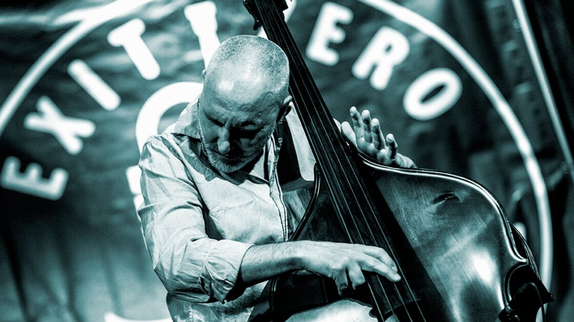 man playing upright bass guitar