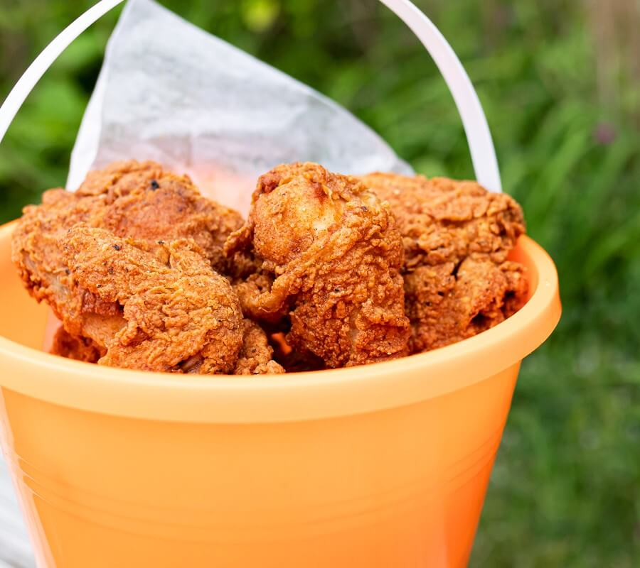 fried chicken in a beach pail