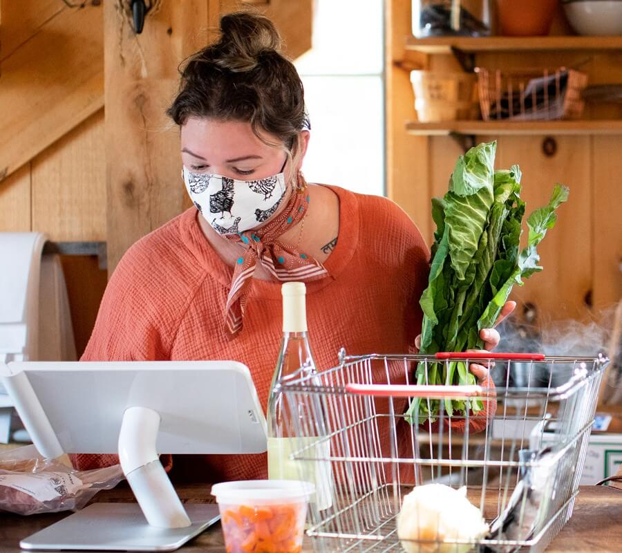 woman wearing a face mask behind counter