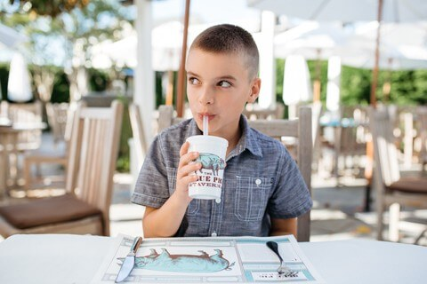 boy drinking from a sippy cup