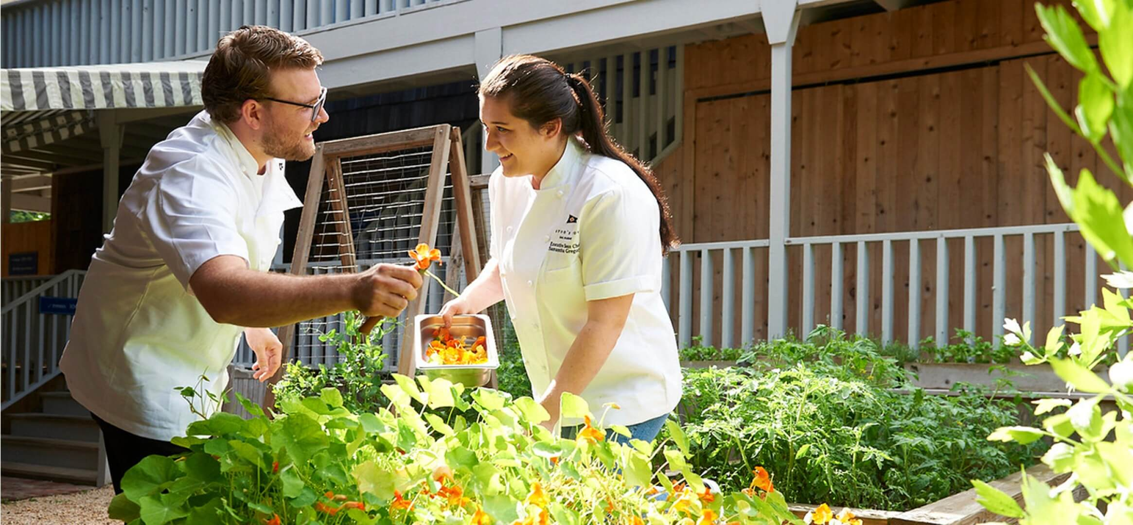 Chef Nicholas and Chef Samantha in the garden at Baron's Cove