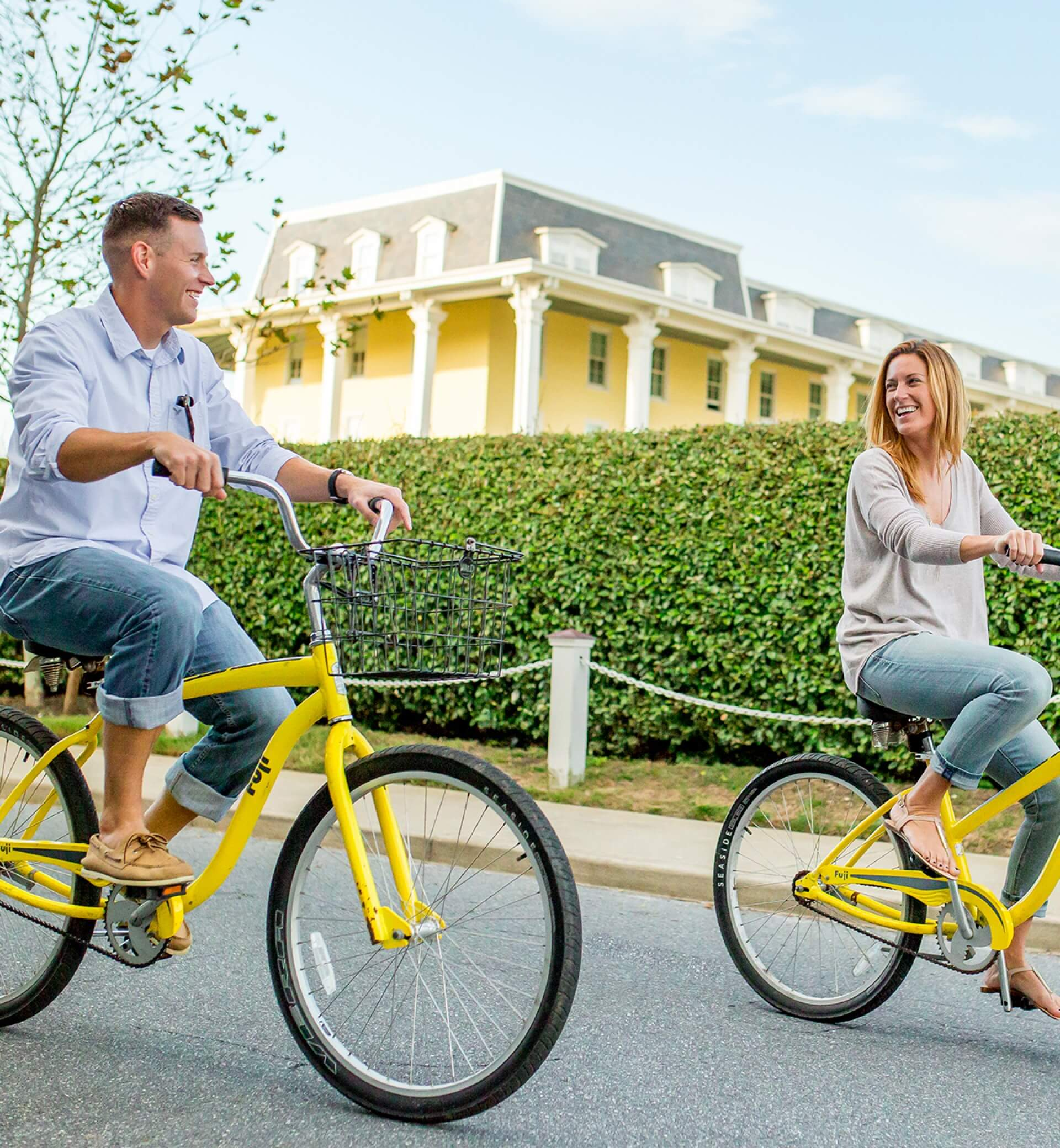 couple riding bikes by congress hall