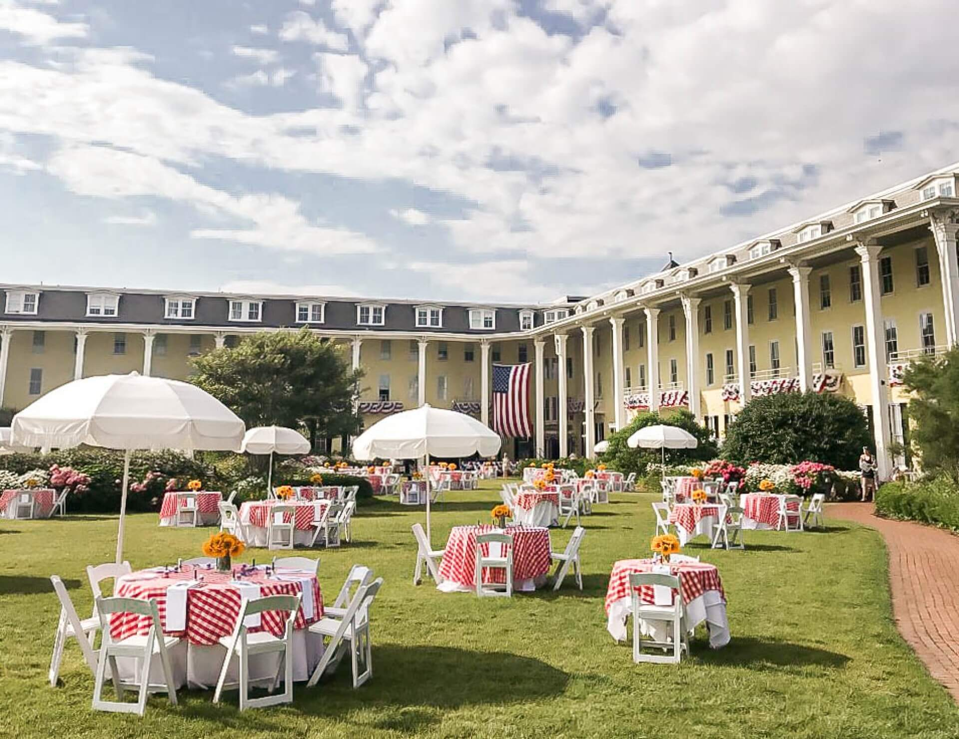 Tables with red gingham table cloth on the Fourth of July at Congress Hall