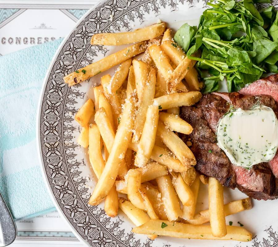 steak and fries on a blue pig tavern plate
